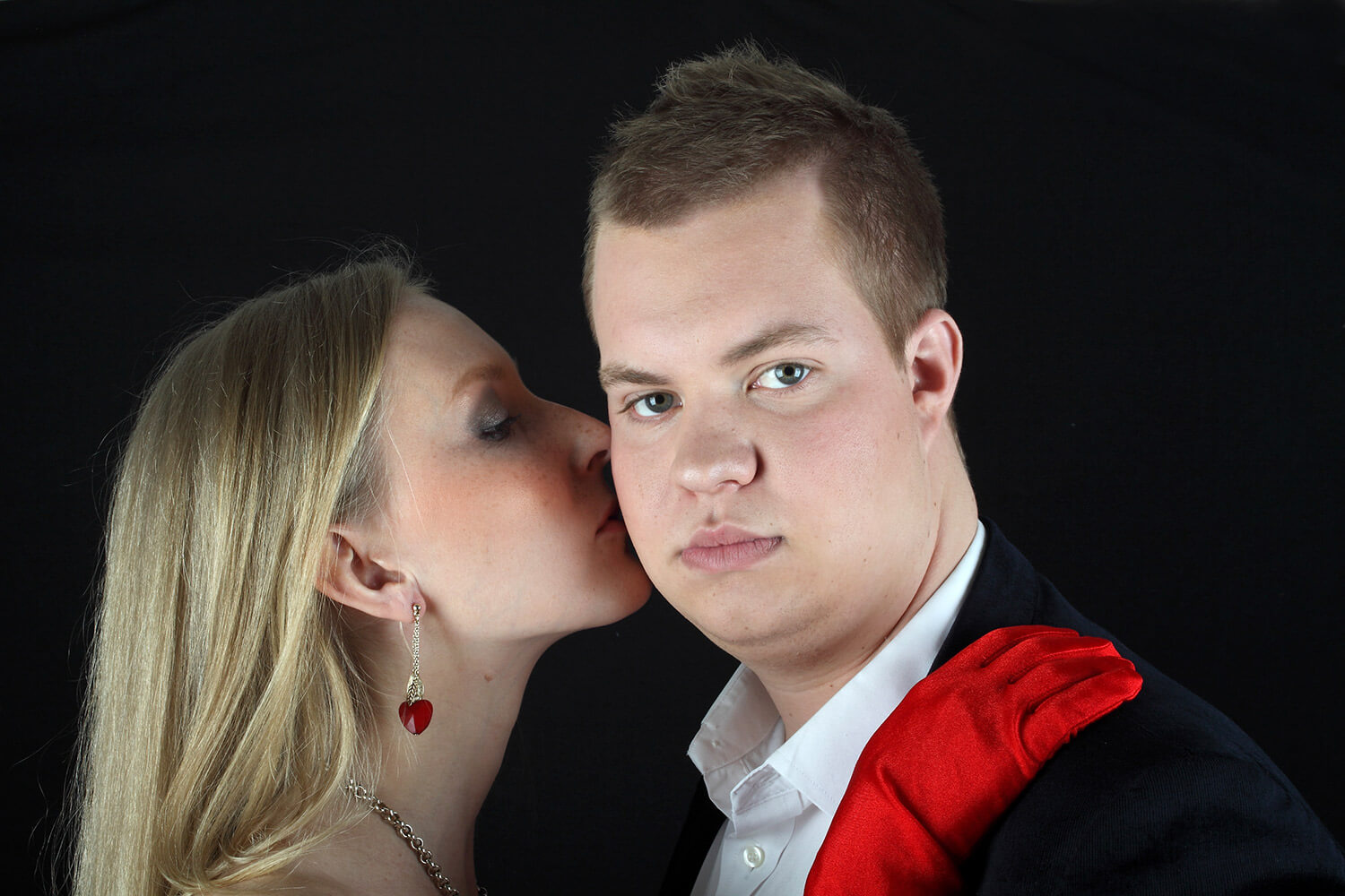 couple photo of a woman with red gloves and a man in a jacket