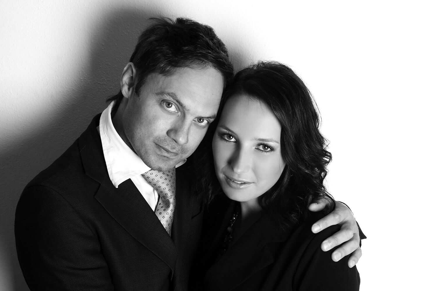 black and white couple photo of a woman and a man on a light background, close-up on faces