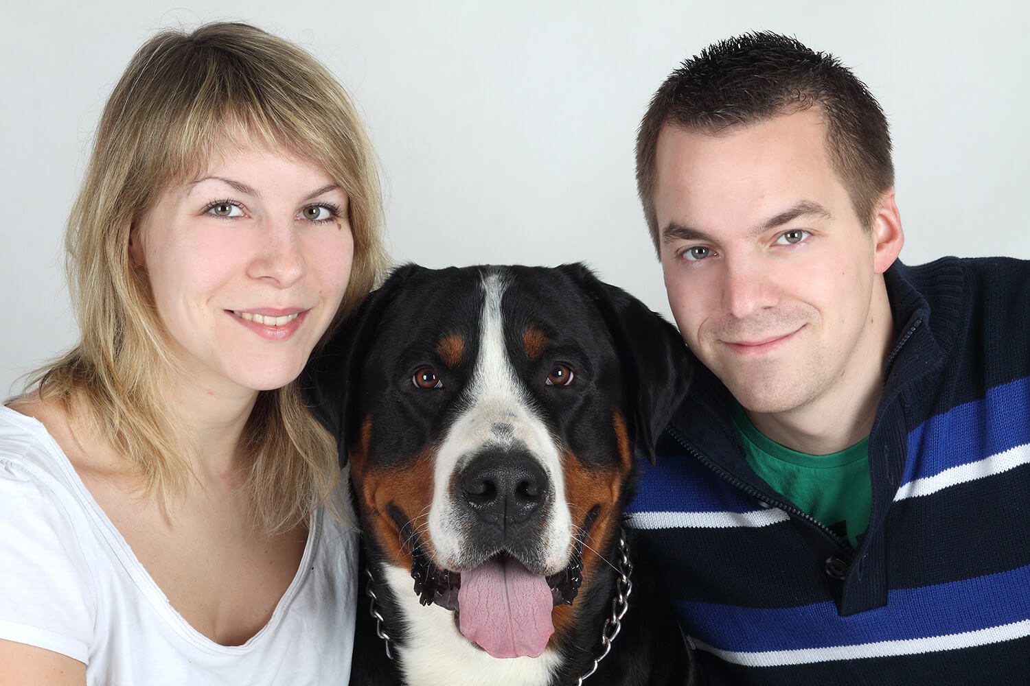 couple photo of a woman, a man, and a dog