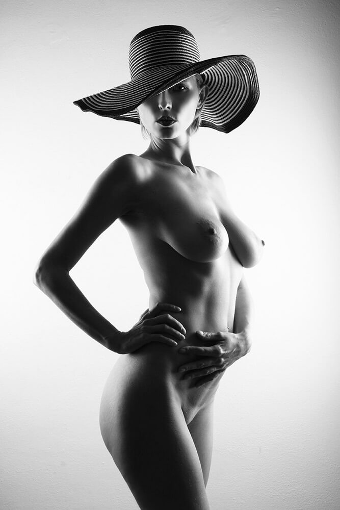 black and white fine art nude of a woman wearing a hat
