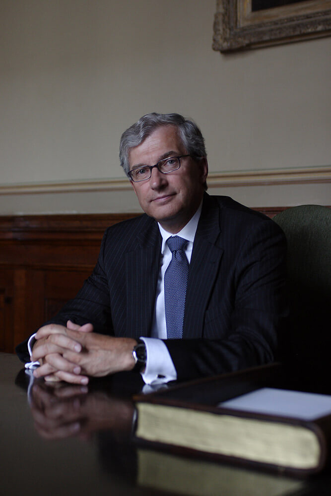 male business portrait at the desk in the study