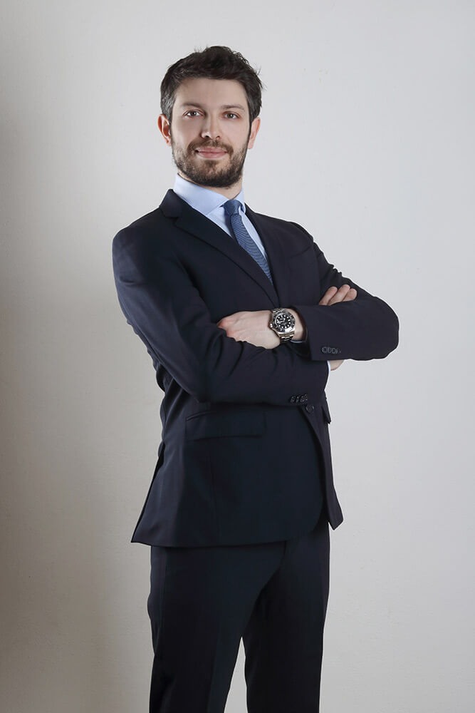 male business portrait in a dark suit on a light background
