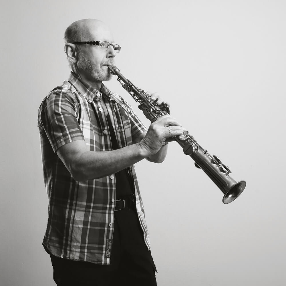 black and white portrait of a man with a clarinet