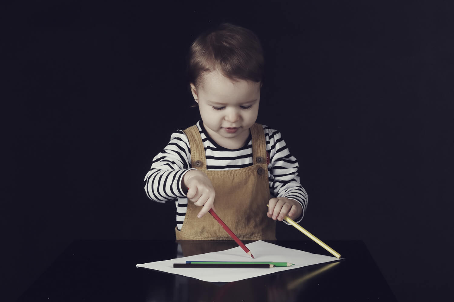 family photo of a drawing little girl on a dark background