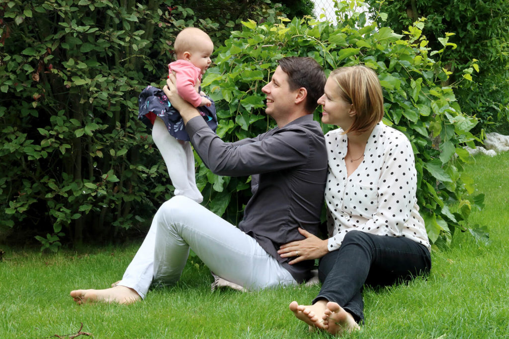 photo of family with toddler in nature