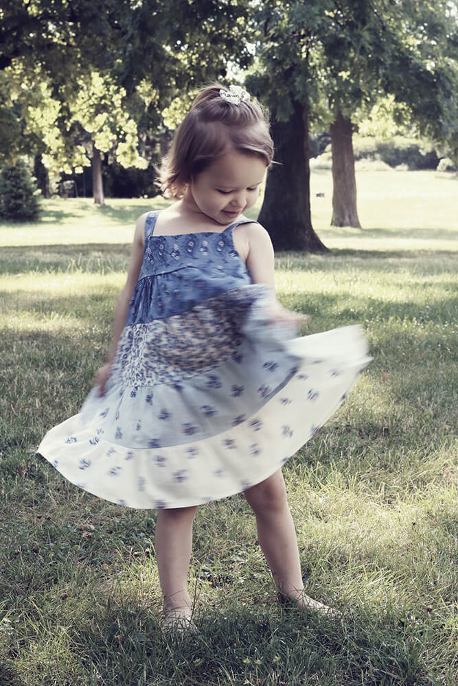 family photo of a little girl in a dress in the park
