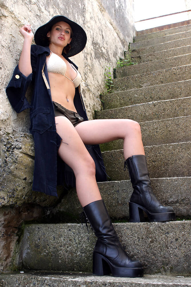 lifestyle photo in a swimsuit, shorts, long shirt, and hat on the stairs