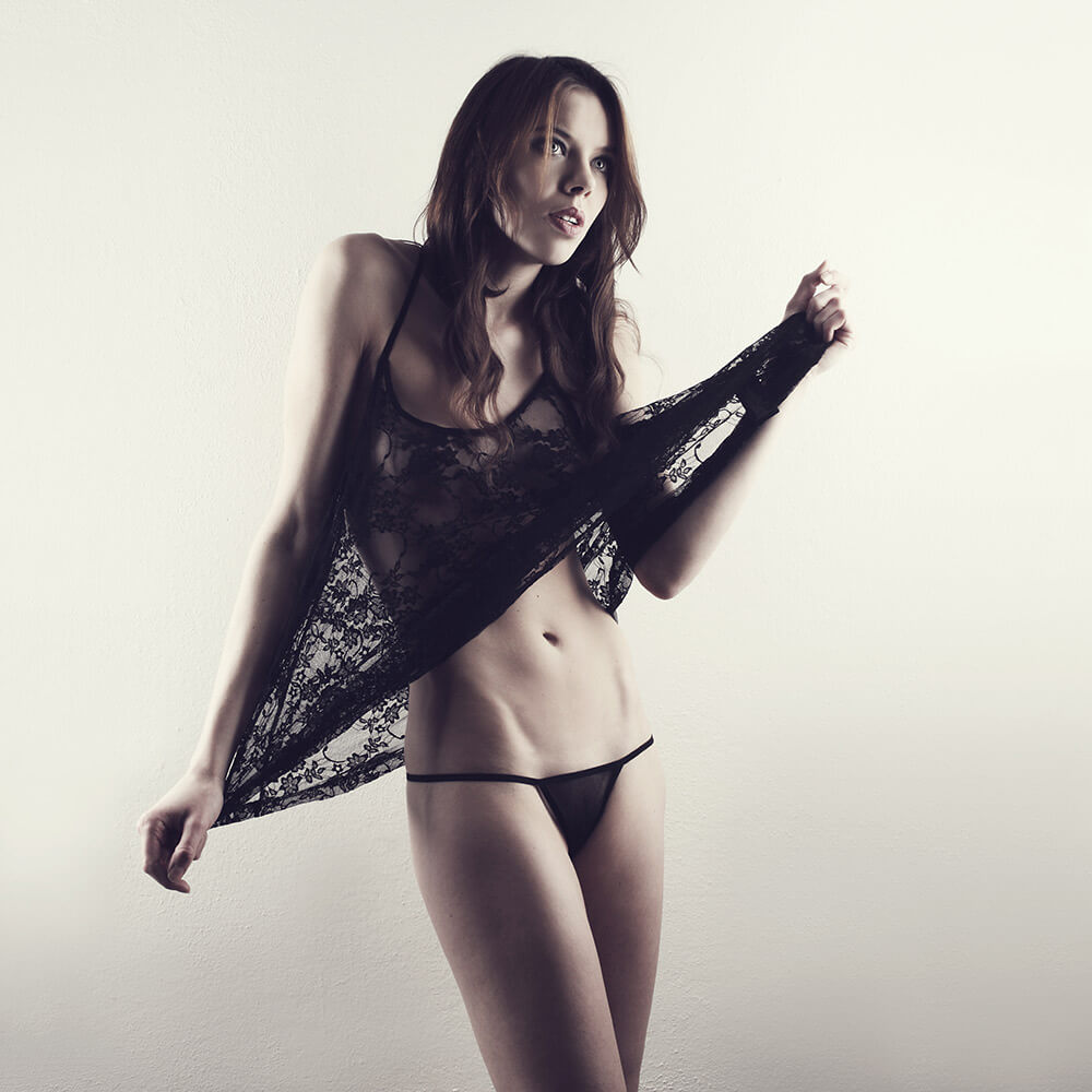 fashion photo of a woman in a black negligee