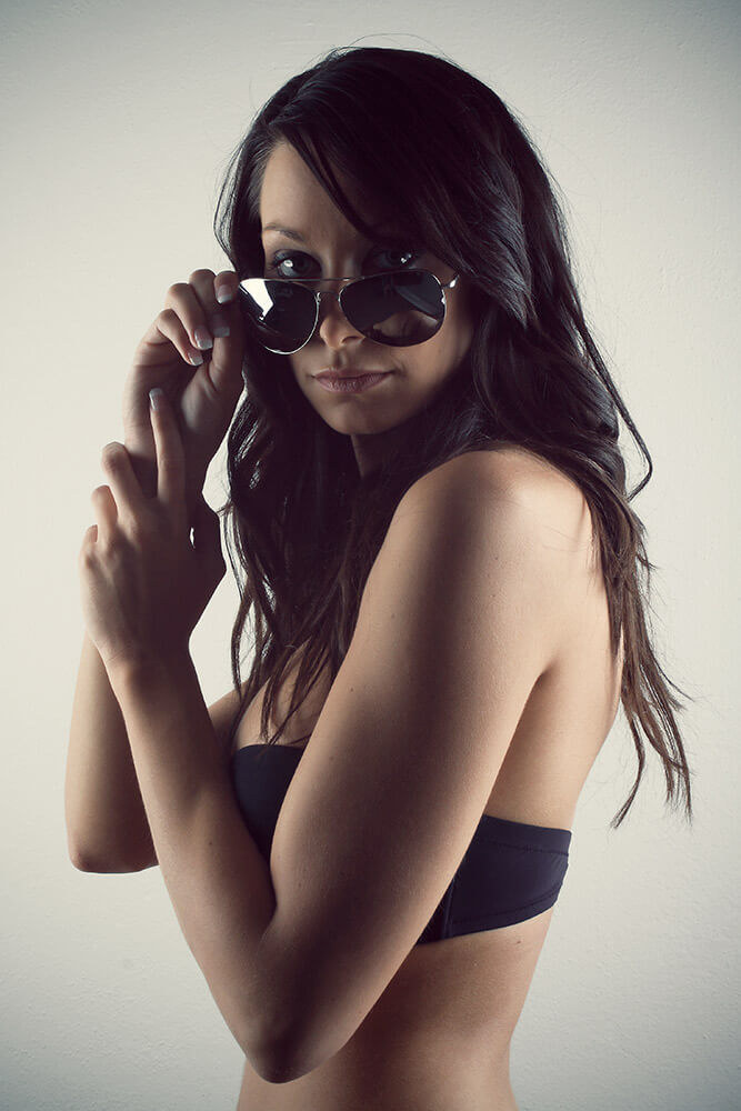 fashion photo of a woman in black lingerie and sunglasses