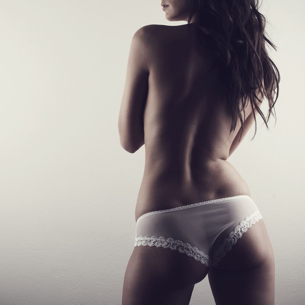 fashion photo of a woman in white lingerie, toned in brown