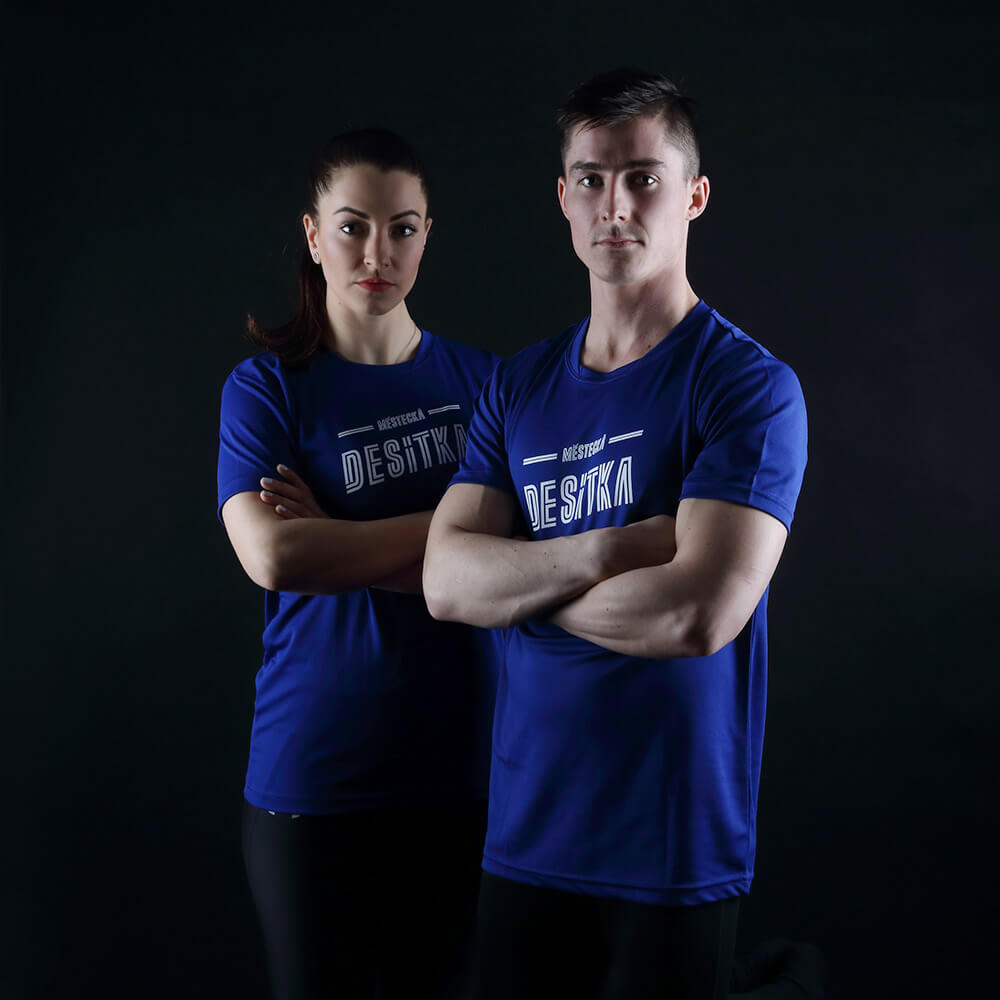 fashion photo of a woman and a man in dark blue T-shirts on a dark background