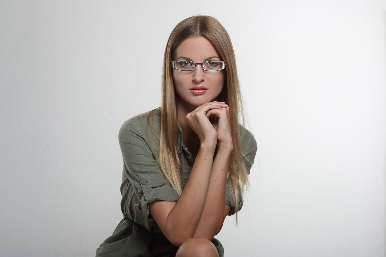 fashion photo of a woman in a green dress and glasses