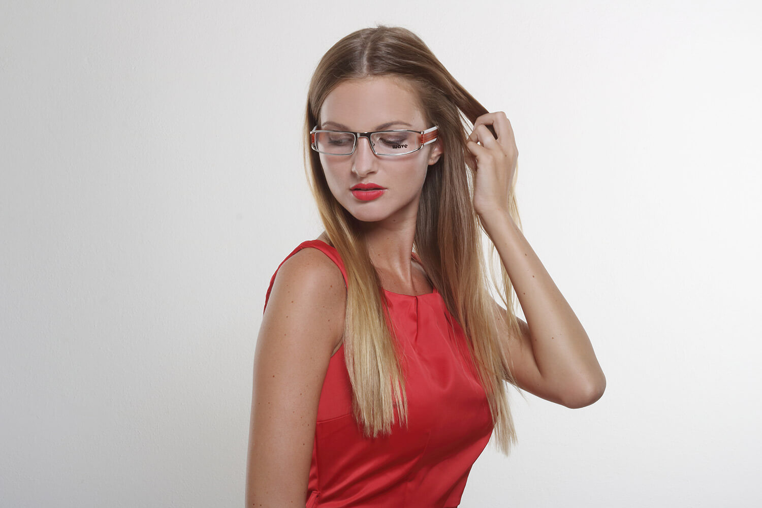fashion photo of a woman in a red dress and eyeglasses