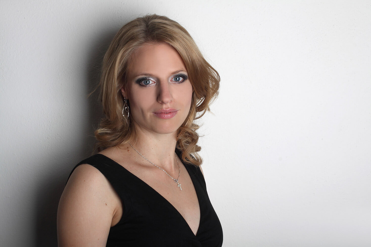 female business portrait in a black dress on a light background