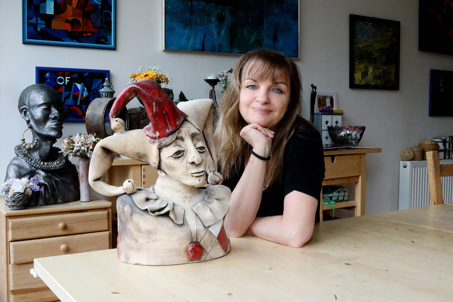 female business portrait with ceramic statue