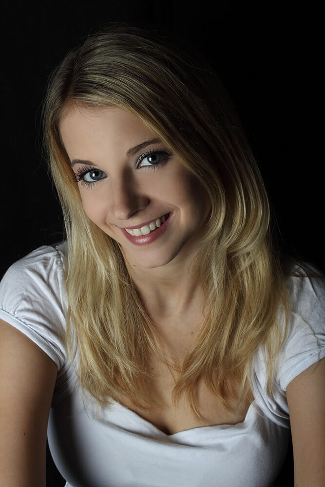 female portrait in a white T-shirt on a dark background